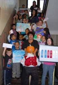 LEO program students with head Lunch Lady and program coordinator Miriam Minniger and their Prizes!